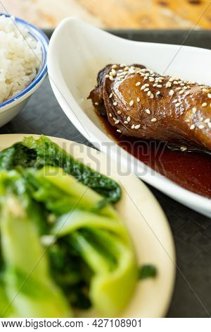 Angle View Fast Food Of Chicken Leg With Vegetable And Rice Vertical Composition