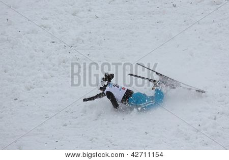 BUKOVEL, UKRAINE - FEBRUARY 23: Zhibek Arapbayeva, Kazakhstan has hard crash landing during Freestyle Ski World Cup in Bukovel, Ukraine on February 23, 2013.