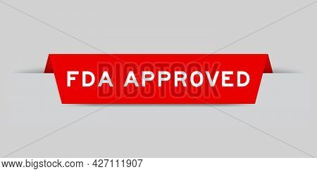Red Color Inserted Label With Word Fda Approved On Gray Background