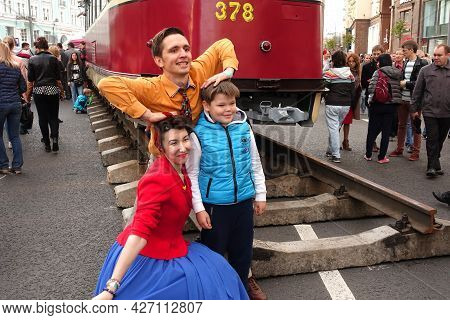 Moscow, Russia, September 10, 2016: Cheerful Family A Man And A Woman And Their Son Pose For Photogr