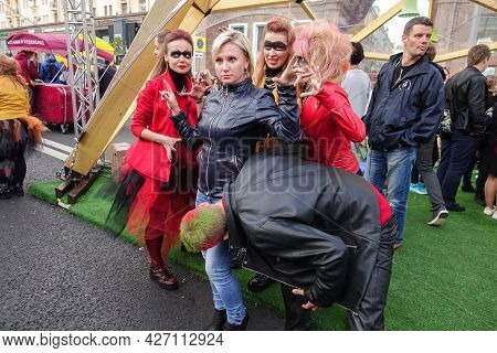 Moscow, Russia, September 10, 2016: A Group Of Cheerful, Cute Young People In Bright Costumes Pose F