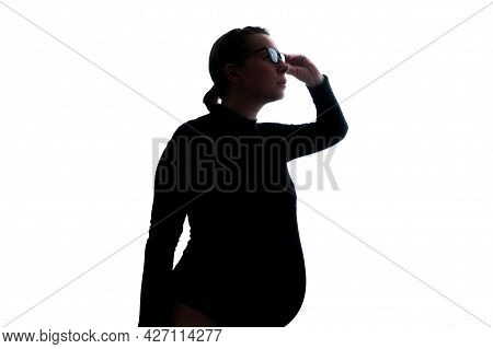 Pregnant Woman Expecting Baby Gazing Through Glasses On Important Information