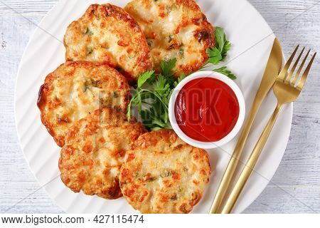 Cheesy Chicken Fritters, Chicken Breast Patties Served With Tomato Sauce On A White Plate, Close-up,