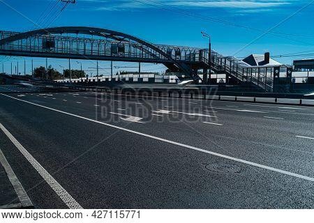 Empty Motorway. Elevated Pedestrian Crossing Across The Road.