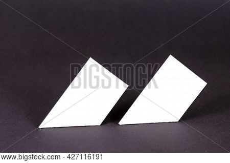 Abstract Geometric Composition Of White Quadrangles On A Gray Background. Two Similar Geometric Shap
