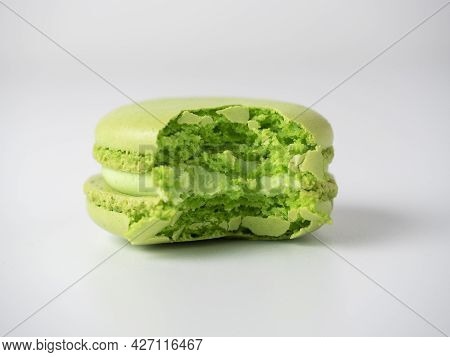 Round Almond Cookies Of Green Color, Bitten On A White Background. Sweetness, Delicious Dessert. Min
