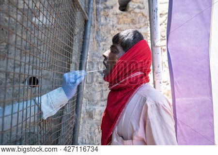 Pithoragarh, India, May, 2021 : A Migrant Worker Being Tested (rtpcr) For Covid-19.