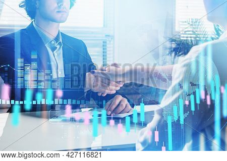 Concept Of Partnership. Business People Handshake Over Candlestick Chart. Hologram Forex Graph Foreg