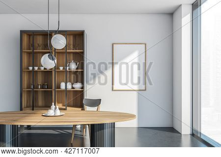 Banner On The White Wall Of Dining Room With Panoramic Window, Cupboard And Interesting Light Above