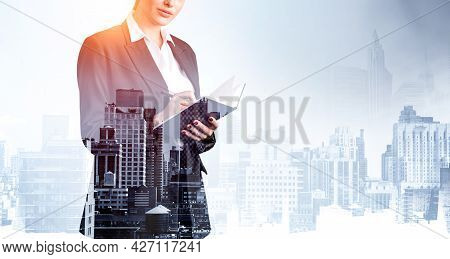 Attractive Businesswoman In Formal Suit And Shirt Is Holding A Planner And Pen, Taking Notes And Dre