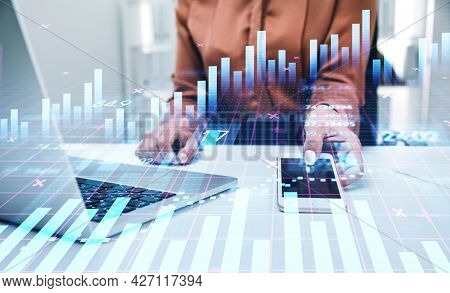 Businesswoman Or Stock Trader Analyzing Stock Graph Chart Using Smartphone With Touchscreen And Lapt