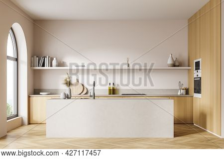 Front View Of The Double Sided Kitchen Area With Arch Window. Sink Opposite The Cabinets And Shelf.