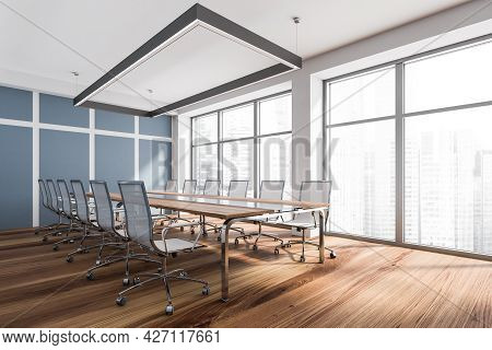 Corner View Of Modern Meeting Room Interior With White, Blue And Wooden Materials, Classy Chandelier