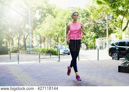 Young Woman Running In The City