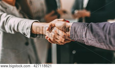 Close Up. Young Casual Business People Shaking Hands With Each