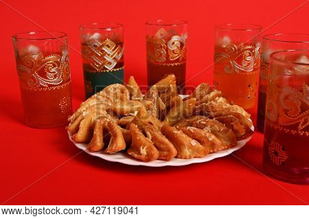 Multicolored Glasses Of Mint Tea In Moroccan Tradition, With Beautiful Decoration And A Plate With A