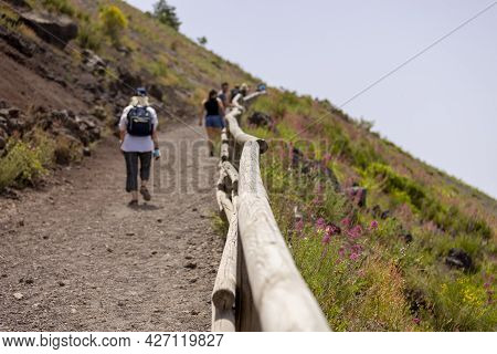 Tourists Walking Along The Footpath To The Top Of Vesuvius Volcano On A Hot Day, Mount Vesuvius, Ita