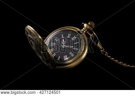 Old Pocket Mechanical Watch Isolated On Black Background. Fashoinable And Antique Accessory.
