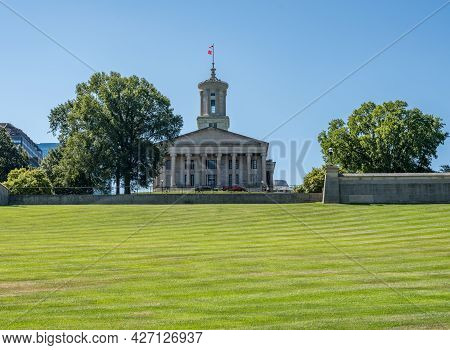 Lawn And Hill Of The Tennessee State Capitol Building In Nashville With The Business District