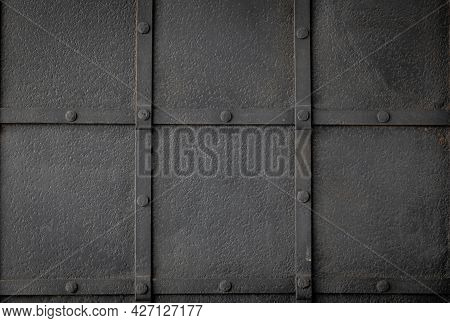 Grunge Black Metal Background With Symmetrically Arranged Trim Strips. Square Grid Finish And Design