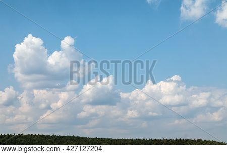Summer Landscape. Lots Of Sky, Horizon Line And A Strip Of Forest. Upsized Texture Clouds. Backgroun