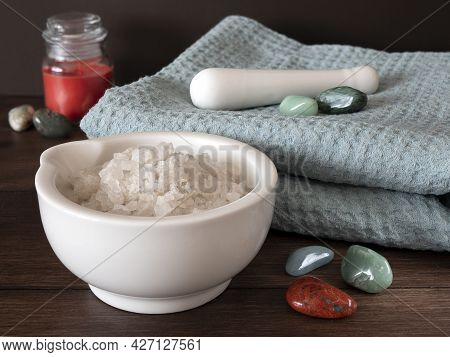 Composition With Sea Salt In A Mortar, Turquois Towel, Candle And Semiprecious Stones On A Wooden Su