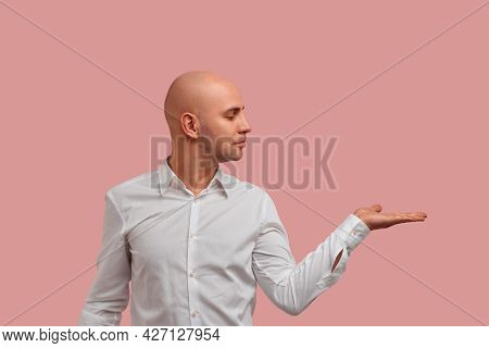 Blank For Advertising. Satisfied Bald Man With Bristle Holds Palm Raised And Keep Copy Space To Adve