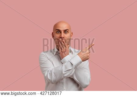 Omg. Did You See That. Shocked Bald Guy Covers Mouth Not Speak, Points To Left With Forefinger, Show