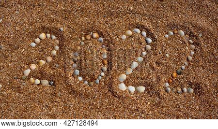 The Figures For 2022 Are Made Up Of Small Shells. The Concept Of The New Year 2022. Summer Holidays