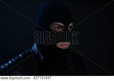 Man Wearing Knitted Balaclava On Black Background