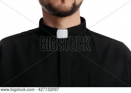 Priest Wearing Cassock With Clerical Collar On White Background, Closeup