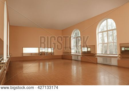 View Of Empty Studio With Mirrors And Ballet Barres