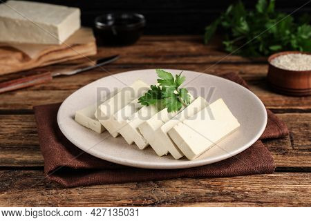 Delicious Tofu With Parsley On Wooden Table