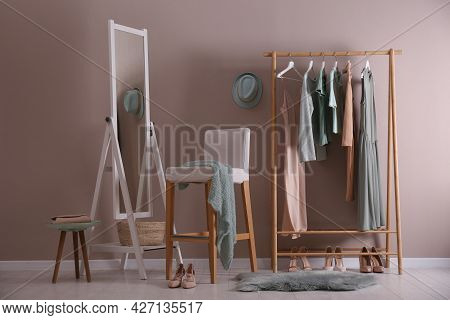 Modern Dressing Room Interior With Clothing Rack, Stool And Mirror
