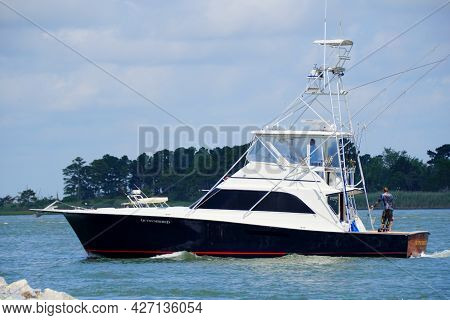 Bethany Beach, Delaware, U.s.a - July 11, 2021 - A Luxury Boat Passing The Water Near Indian River I