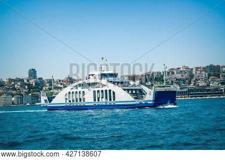 Kadikoy, Istanbul, Turkey - 06.10.2021: Wide Angle View Of Blue White Ferryboat Carrying Cars And Ve