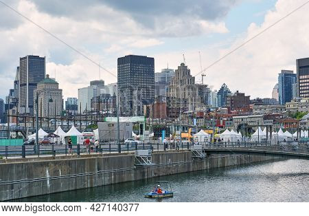 Canada, Montreal - July 11, 2021: Scenic View Of Old Port Of Montreal. Old Port Is Historic Place, L