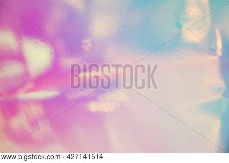 Light reflections in holographic foil, colourful abstract background