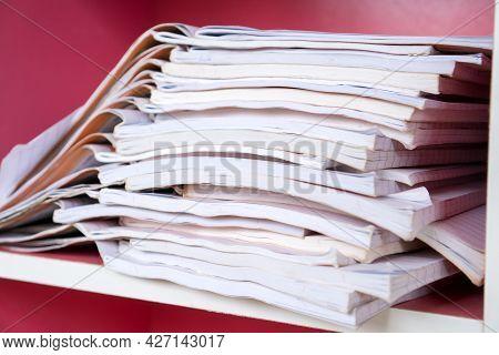Pile Of Stack Orange Student Homework Book Of High School Students On Teacher Desk Waiting For Revie