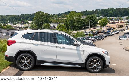 Monroeville, Pennsylvania, Usa July 18, 2021 Different Colored Bmw Suvs Lined Up Downhill At A Deale