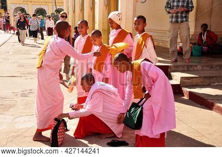 Burmese Nuns Women Group Travel Visit Respect Praying Of Shwezigon Pagoda Paya Stupa Chedi Temple In