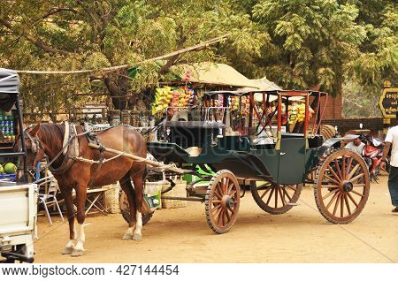 Burmese Sit Ride Horse Drawn Carriages And Waiting For Burma People And Foreign Travelers Use Servic