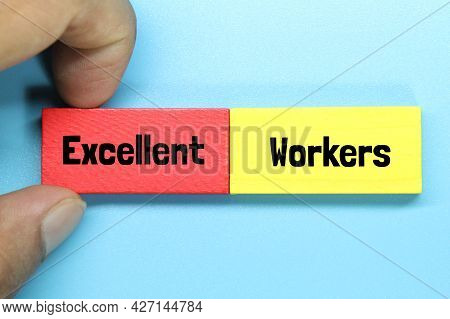 Hand Holding A Colored Block Board With The Words Excellent Workers