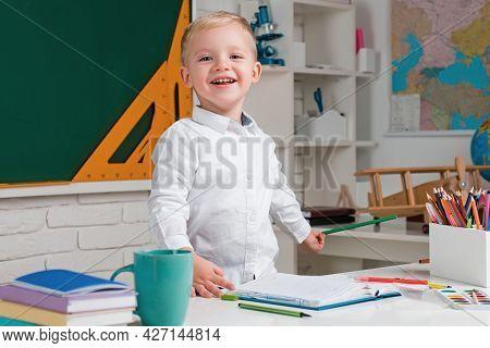 Individual Teaching. Cute Little Preschool Kid Boy With Teacher Study In A Classroom. Educational Pr