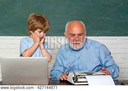Pupil Preparing For Test Or Exam. Man Teaches Child. Young Serious Male Pupil Studying In School. Po