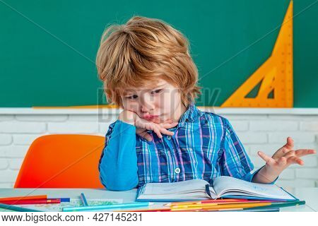 Child Home Studying And Home Education. School Kids Against Green Chalkboard. Home School For Pupil.