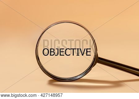 Business Objective Target And Goal Concept, Black Objective Wording On Magnifier Glass.