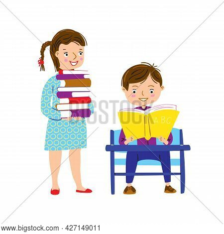 Schoolchildren In School Library. Boy Reading Textbook At Desk And Girl Brought Several Books. Back