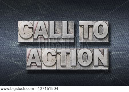 Call To Action Phrase Made From Metallic Letterpress On Dark Jeans Background