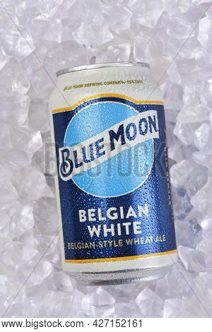IRIVNE, CALIFORNIA - 17 JUL 2021: A Can of Blue Moon Belgian White Ale in a bed of Ice.